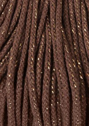 brunt garn med gull til interiør